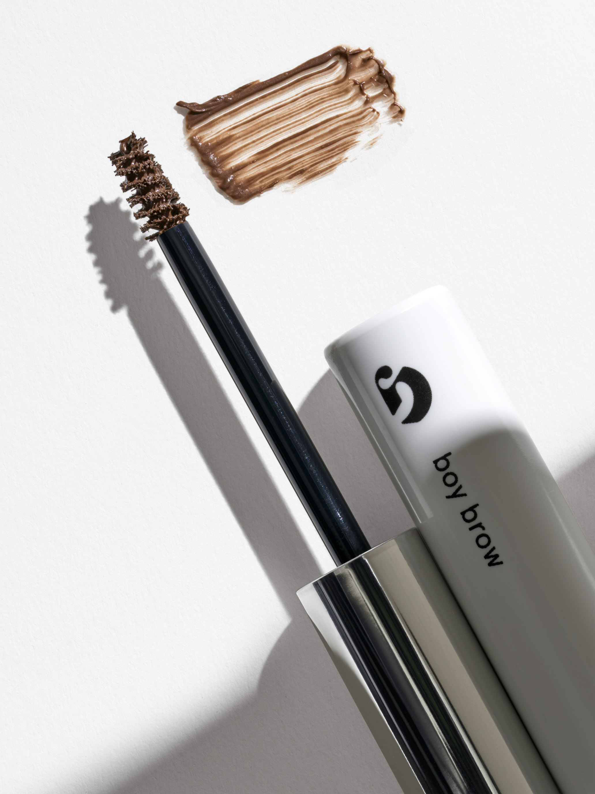 STAN Glossier Boy Brow Product with Open Wand and Texture Smear