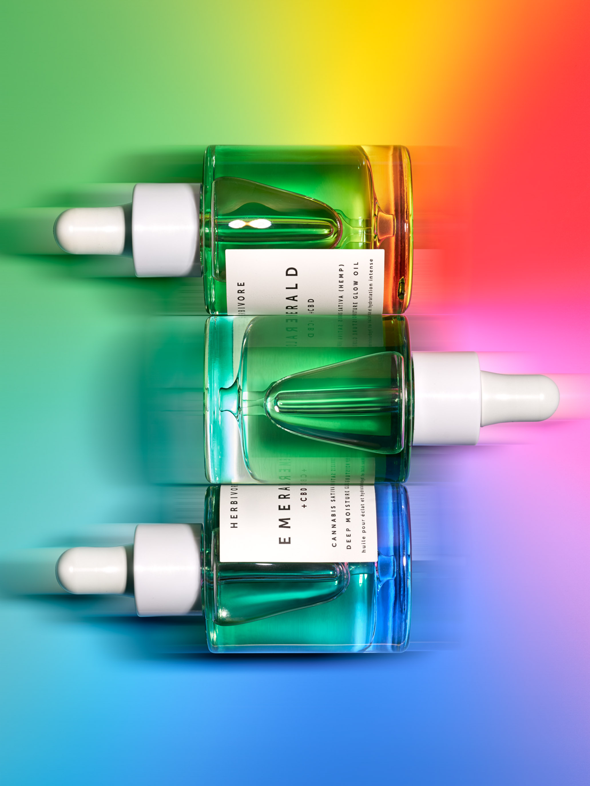 STAN Herbivore Emerald CBD Editorial Still Life on Rainbow Colors